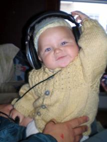 Cute Baby in Knit Cardigan Pattern