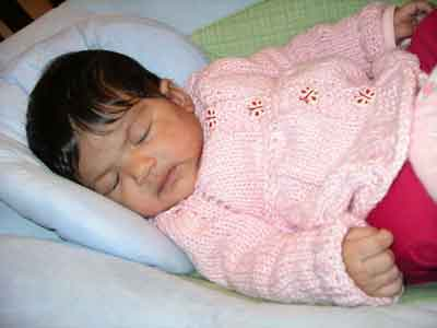 Cute Baby Photo in Cabled Baby Jacket Knitting Pattern