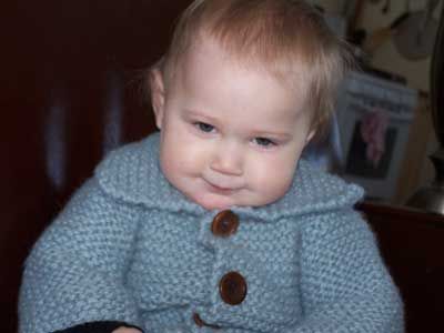Cute Baby Photo in Chunky Cardigan knitting project